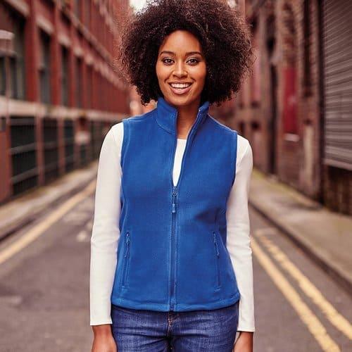 Woman wearing a blue fleece gilet