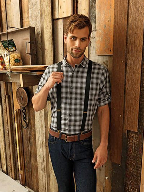 man wearing check shirt with rolled sleeves
